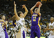 December 22 2010: Northern Iowa guard/forward Erin Brocka (44) grabs a rebound over Iowa forward Kalli Hansen (3) during the second half of an NCAA college basketball game at Carver-Hawkeye Arena in Iowa City, Iowa on December 22, 2010. Iowa defeated Northern Iowa 75-64.