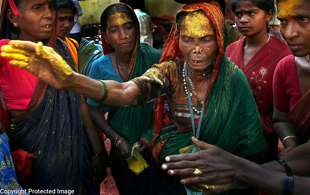 An older woman acts as a medium between the deity, Yellamma, and her worshippers during a religious festival in Saundatti, India.  She enters a trance-like state and devotees watch in awe as the deity begins to speak through her. The medium cries out, shakes uncontrollably and often collapses in exhaustion at the end of the session. This provides worshippers more direct contact with the deity and the woman is duly compensated.