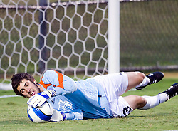 Old Dominion Monarchs goalkeeper Brennan Kirkpatrick (23) makes a diving save against UVA.  The Virginia Cavaliers defeated the Old Dominion Monarchs 3-0 in a pre-season NCAA Men's Soccer exhibition game held at Klockner Stadium on the Grounds of the University of Virginia in Charlottesville, VA on August 23, 2008.