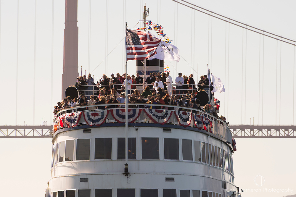 Crowded upper decks of the California Hornblower sight seeing boat on San Francisco harbor.