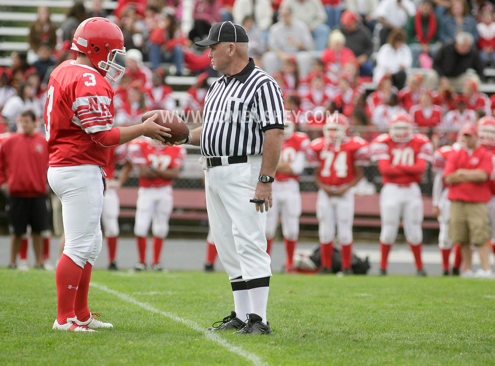 Thiells, New York - A referee hands the fooball to a North Rockland kicker during a high school football game against Ramapo on Sept. 26, 2009.