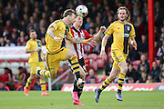 Brentford attacker, Sergi Canos (47) battling for ball with Fulham defender, Fernando Amorebieta (45) during the Sky Bet Championship match between Brentford and Fulham at Griffin Park, London, England on 30 April 2016. Photo by Matthew Redman.
