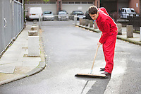 Young male street sweeper
