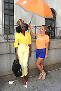 IMAGE DISTRIBUTED FOR ACCUWEATHER -  Stylist/Blogger Hazel Dennis is shaded from the hot summer sun by the AccuWeather MinuteCast street team at New York Fashion Week, on Tuesday, Sept. 15, 2015. The AccuWeather MinuteCast Street Team is at it again helping Fashion Week attendees stay stylish and one-step ahead of any possible precipitation. (Photo by Diane Bondareff/Invision for AccuWeather/AP Images)