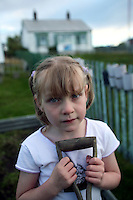 Emmaleigh Middleton, 5, takes a beak from helping her mom dig up potatoes in the family garden in Stanley, the capital of the Falkland Islands, on Wednesday, March 21, 2007. This year is the 25 anniversary of the war for sovereignty of the islands between the United Kingdom and Argentina. The two-month war resulted in the withdrawal of Argentinean forces and the islands remained part of the United Kingdom. After the war on the islands there has been strong economic development. (Photo/Scott Dalton)