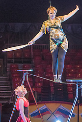© Licensed to London News Pictures. 22/04/2015. Guildford, UK.Kelly-Marie Blundell is guided through the process by comedy artist Vladimir Georgieski and high wire walker Olga Roxhkovskaya. Liberal Democrat Kelly-Marie Blundell walks the high wire at Moscow State Circus in Guildford. Photo credit : Stephen Simpson/LNP