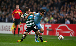 MANCHESTER, ENGLAND - Thursday, March 15, 2012: Manchester City's Sergio Aguero in action against Sporting Clube de Portugal's Bruno Pereirinha during the UEFA Europa League Round of 16 2nd Leg match at City of Manchester Stadium. (Pic by Vegard Grott/Propaganda)