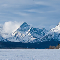 saint mary's lake and mountains, snow coverd winter, glacier national park