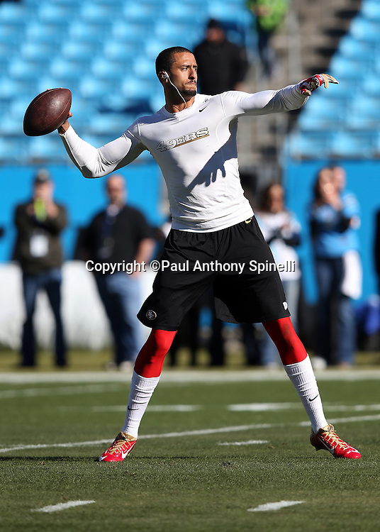 San Francisco 49ers quarterback Colin Kaepernick (7) throws a pass while warming up before pregame warmups at the NFC Divisional Playoff NFL football game against the Carolina Panthers on Sunday, Jan. 12, 2014 in Charlotte, N.C. The 49ers won the game 23-10. ©Paul Anthony Spinelli