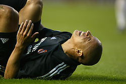 MANCHESTER, ENGLAND - Wednesday, April 23, 2003: Real Madrid's Roberto Carlos lies injured on the floor against Manchester United during the UEFA Champions League Quarter Final 2nd Leg match at Old Trafford. (Pic by David Rawcliffe/Propaganda)