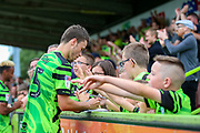 Forest Green Rovers celebrate and sign autographs at the end of the game during the EFL Sky Bet League 2 match between Forest Green Rovers and Oldham Athletic at the New Lawn, Forest Green, United Kingdom on 3 August 2019.