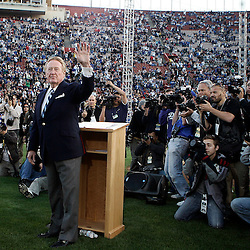 The Dodgers long time Hall of Fame broadcaster Vin Scully waves to the crowd as was honored during pre-game ceremonies for his six-decades of service to the Dodgers with a commemorative bronze plaque at the peristyle entrance to the coliseum. Scully called games at the coliseum from 1958-1961 and his 59 years of service is a Major League Record. The Dodgers celebrating there 50th season in Los Angeles played an exhibition game against the Boston Redsox's March 29. 2008 at the Los Angeles Memorial Coliseum. (SGVN/Staff Photo Keith Birmingham/SXSports)