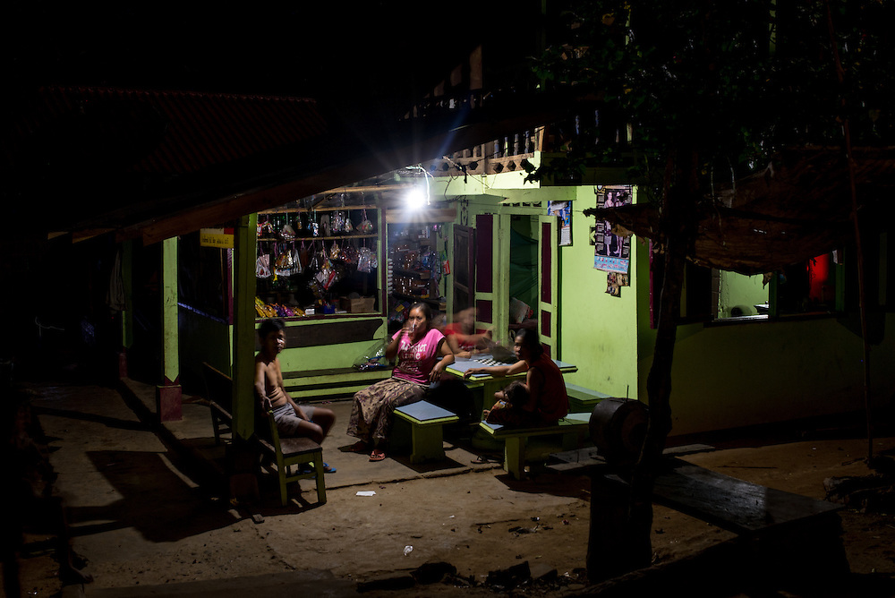 A shop in the village of Khoc Kham is lit by an LED buld powered by a portable water turbine. The village is not connected to the main electrical grid and many residents operate their own turbines to power lights and sometimes small appliances.