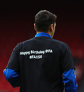 Picture by David Horn/Focus Images Ltd +44 7545 970036<br /> 26/10/2013<br /> Mesut Ozil of Arsenal wearing a t-shirt celebrating The FA 150 Years celebration that says 'Happy Birthday @FA #FA150' before during the Barclays Premier League match at Selhurst Park, London.