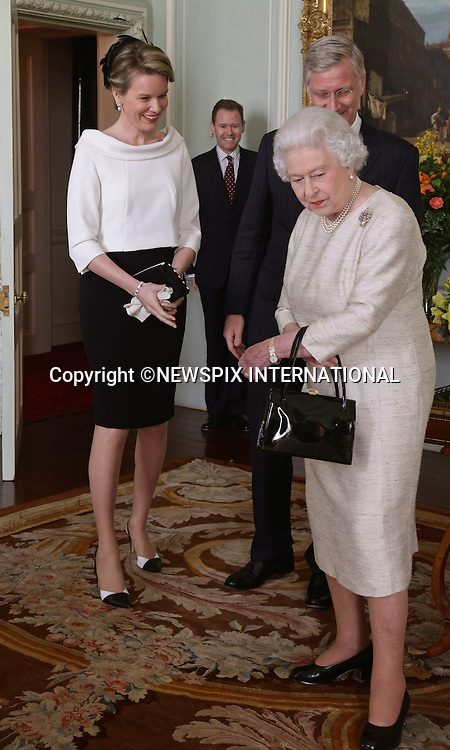 KING PHILIPPE AND QUEEN MATHILDE OF BELGIUM UK VISIT<br /> Queen Elizabeth II greets King Philippe and Queen Mathilde of Belgium at Buckingham Palace, London. <br /> Mandatory Credit Photo: &copy;Pool/NEWSPIX INTERNATIONAL<br /> <br /> **ALL FEES PAYABLE TO: &quot;NEWSPIX INTERNATIONAL&quot;**<br /> <br /> IMMEDIATE CONFIRMATION OF USAGE REQUIRED:<br /> Newspix International, 31 Chinnery Hill, Bishop's Stortford, ENGLAND CM23 3PS<br /> Tel:+441279 324672  ; Fax: +441279656877<br /> Mobile:  07775681153<br /> e-mail: info@newspixinternational.co.uk