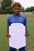 AFC Wimbledon midfielder Ossama Ashley (36) holding Fifa sign during the AFC Wimbledon 2018/19 official photocall at the Kings Sports Ground, New Malden, United Kingdom on 31 July 2018. Picture by Matthew Redman.