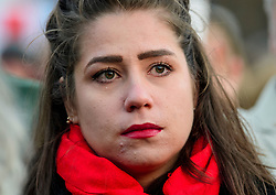 © Licensed to London News Pictures. 23/03/2017. London, UK. A woman sheds a tear during a vigil, held in Trafalgar Square, London, to remember those killed in the Westminster terror attack, the day after a lone terrorist killed 4 people and injured several more, in an attack using a car and a knife. The attacker managed to gain entry to the grounds of the Houses of Parliament, killing one police officer. Photo credit: Ben Cawthra/LNP