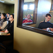 "Nathan and Emily Briux listen to a sermon in the cry room with their three-month-old son Ethan on Sunday, March 2, 2008 at Quest Church in the Interbay ""neighborhood"" in Seattle.  Without residents in the ""neighborhood"" the church has become one of the community focal points and gathering places.  (Seattle Post-Intelligencer / Joshua Trujillo)"