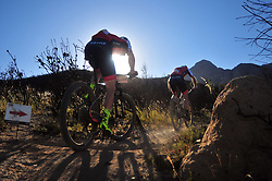 WELLINGTON SOUTH AFRICA - MARCH 23: Riders from team Centurion Vaude during stage five's 39km time trial on March 23, 2018 in Wellington, South Africa. Mountain bikers gather from around the world to compete in the 2018 ABSA Cape Epic, racing 8 days and 658km across the Western Cape with an accumulated 13 530m of climbing ascent, often referred to as the 'untamed race' the Cape Epic is said to be the toughest mountain bike event in the world. (Photo by Dino Lloyd)