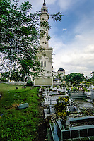 Indonesia, Sumatra. Medan. The Great Mosque (Masjid Raya) of Medan built in 1906 in Moroccan style. The cemetery.