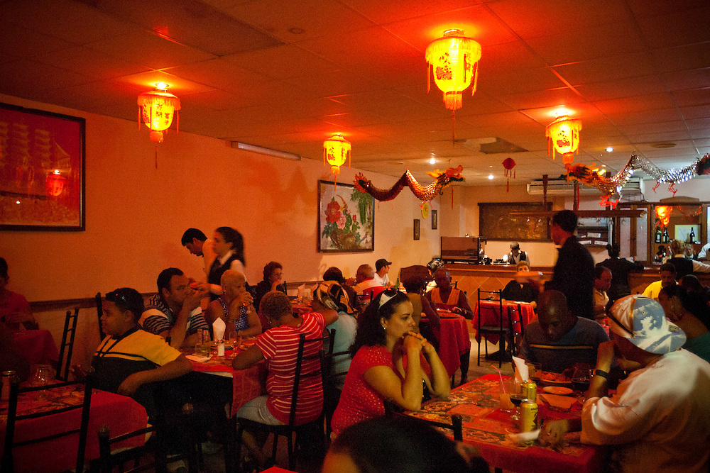 Cubans have lunch at a Chinese restaurant in Barrio Chino, Havana, Cuba, on Friday, April 19, 2009. Before the Cuban revolution, Barrio Chino was the largest Chinatown in all of Latin America. Today, the neighborhood is a mere shadow of its former self. Less than 300 Chinese-born immigrants live throughout Cuba..