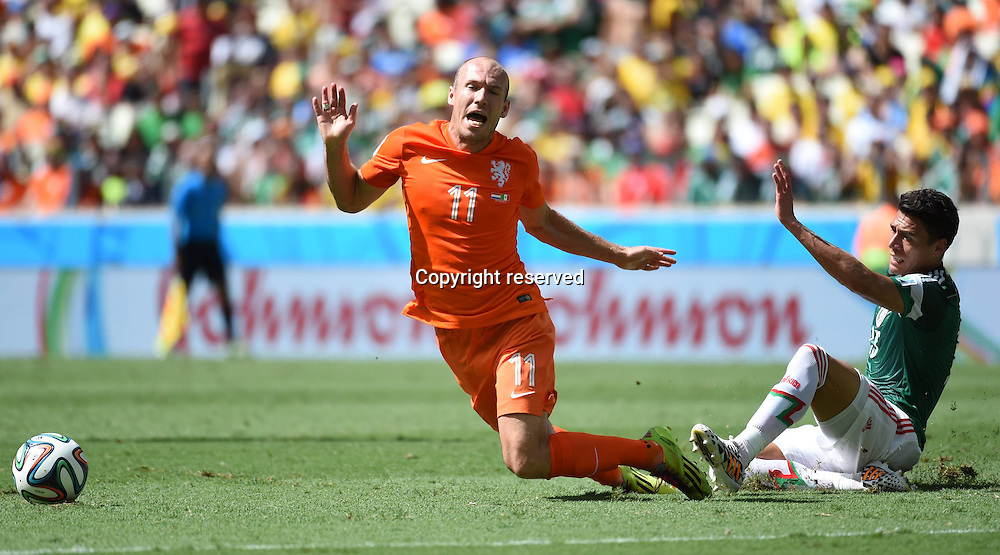 29.06.2014. Fortaleza, Brazil. Netherlands Arjen Robben (L) is tripped by Mexcicos Hector Moreno during a Round of 16 match between Netherlands and Mexico of 2014 FIFA World Cup at the Estadio Castelao Stadium in Fortaleza, Brazil, on June 29