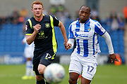 Colchester United's Kyel Reid(17) Carlisle United's James Brown battles for possession  during the EFL Sky Bet League 2 match between Colchester United and Carlisle United at the Weston Homes Community Stadium, Colchester, England on 14 October 2017. Photo by Phil Chaplin