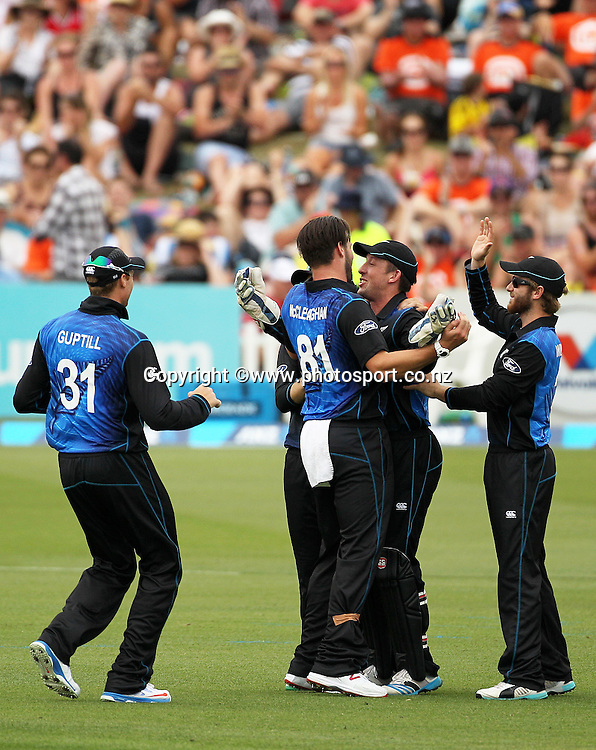 Mitchell McClenaghan of the Black Caps celebrates the wicket of Thisara Perera of Sri Lanka with team mates Luke Ronchi and Kane Williamson during the first ODI cricket game between the Black Caps v Sri Lanka at Hagley Oval, Christchurch. 11 January 2015 Photo: Joseph Johnson / www.photosport.co.nz