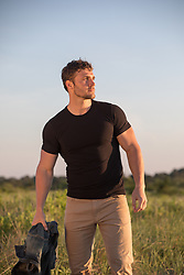 sexy man outdoors in the countryside at sunset