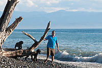 Sean walks and plays with the dogs along French Beach, along the Juan de Fuca trail on Vancouver Island.
