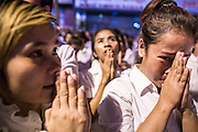 """04 FEBRUARY 2013 - PHNOM PENH, CAMBODIA:  Cambodians cry out and pray at the cremation of their former King Norodom Sihanouk during the King-Father's cremation service in Phnom Penh. Norodom Sihanouk (31 October 1922- 15 October 2012) was the King of Cambodia from 1941 to 1955 and again from 1993 to 2004. He was the effective ruler of Cambodia from 1953 to 1970. After his second abdication in 2004, he was given the honorific of """"The King-Father of Cambodia."""" Sihanouk died in Beijing, China, where he was receiving medical care, on Oct. 15, 2012.   PHOTO BY JACK KURTZ"""