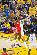 Golden State Warriors guard Klay Thompson (11) defends Houston Rockets guard James Harden (13) during Game 6 of the Western Conference Finals at Oracle Arena in Oakland, Calif., on May 26, 2018. (Stan Olszewski/Special to S.F. Examiner)