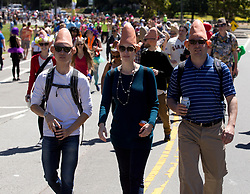 A trio of walkers dressed as Coneheads pass through Golden Gate Park, during the 105th running of the Bay to Breakers 12k, Sunday, May 15, 2016 in San Francisco. The 7.42-mile race from San Francisco Bay to the Pacific Ocean, attracts a field of tens of thousands of runners, from the elite to the weekend warrior, some clad in costume and some in nothing at all. (Photo by D. Ross Cameron)