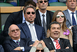 © Licensed to London News Pictures. 6th July 2014. London. UK. Larry Ellison of Oracle watches from the Royal Box. Crowds and celebrities watch the The Men's Final between Roger Federer, SUI v Novak Djokovic, SER at the Wimbledon Tennis Championships 2014. Photo credit :  Mike King/LNP