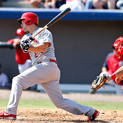 Mar 8, 2013; Melbourne, FL, USA; St. Louis Cardinals third baseman David Freese (23) singles against the Washington Nationals during the top of the third inning of a spring training game at Space Coast Stadium. Mandatory Credit: Derick E. Hingle-USA TODAY Sports
