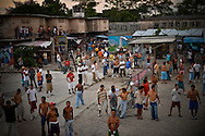 Inmates pass the afternoon in the yard of Esperanza men's prison in San Salvador, El Salvador. Esperanza is extremely overcrowded, cramming close to 40 inmates into small cells. Incarcerated men sleep in lines on the floor, in spaces underneath bunk beds, and even in bathrooms. Several inmates said their primary complaint was their lack of access to clean water.