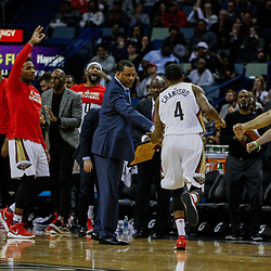 Mar 14, 2017; New Orleans, LA, USA; New Orleans Pelicans guard Jordan Crawford (4) celebrates with head coach Alvin Gentry after a three point basket against the Portland Trail Blazers during the second half of a game at the Smoothie King Center. The Pelicans defeated the Trail Blazers 100-77. Mandatory Credit: Derick E. Hingle-USA TODAY Sports