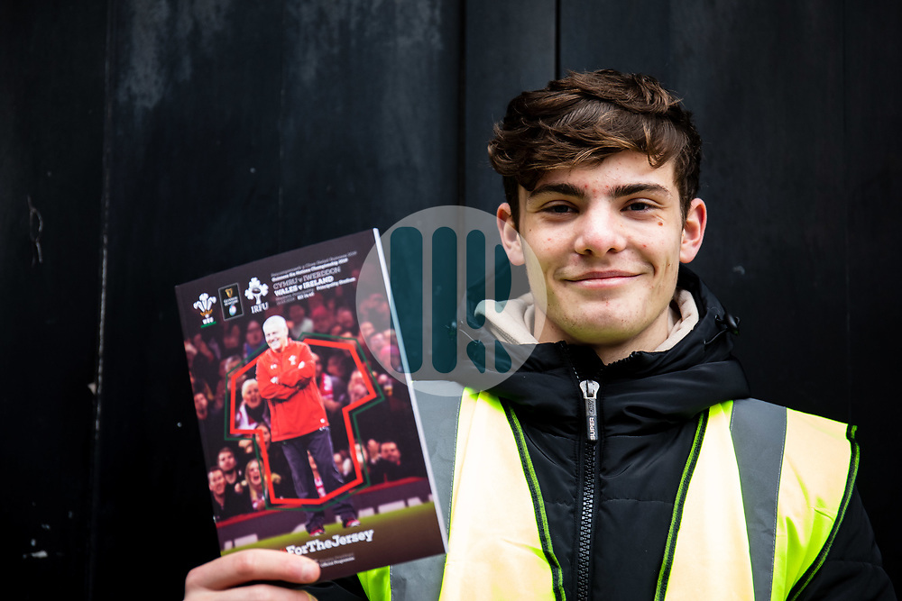 A programme seller outside of the stadium<br /> <br /> Photographer Simon King/Replay Images<br /> <br /> Six Nations Round 5 - Wales v Ireland - Saturday 16th March 2019 - Principality Stadium - Cardiff<br /> <br /> World Copyright © Replay Images . All rights reserved. info@replayimages.co.uk - http://replayimages.co.uk