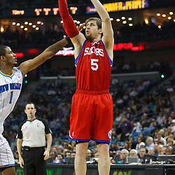 January 3, 2011; New Orleans, LA, USA; Philadelphia 76ers forward Andres Nocioni (5) shoots over New Orleans Hornets small forward Trevor Ariza (1) during the first quarter at the New Orleans Arena.   Mandatory Credit: Derick E. Hingle