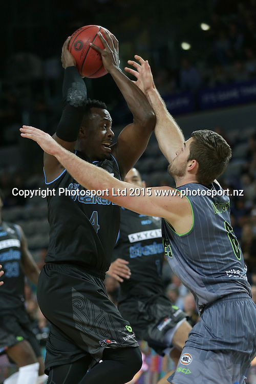 Breakers` Cedric Jackson is challenged by Crocodiles' Mitch Norton in an ANBL Basketball Match, New Zealand Breakers v Townsville Crocodiles, Vector Arena, Auckland, New Zealand, Sunday, October 11, 2015. Copyright photo: David Rowland / www.photosport.nz