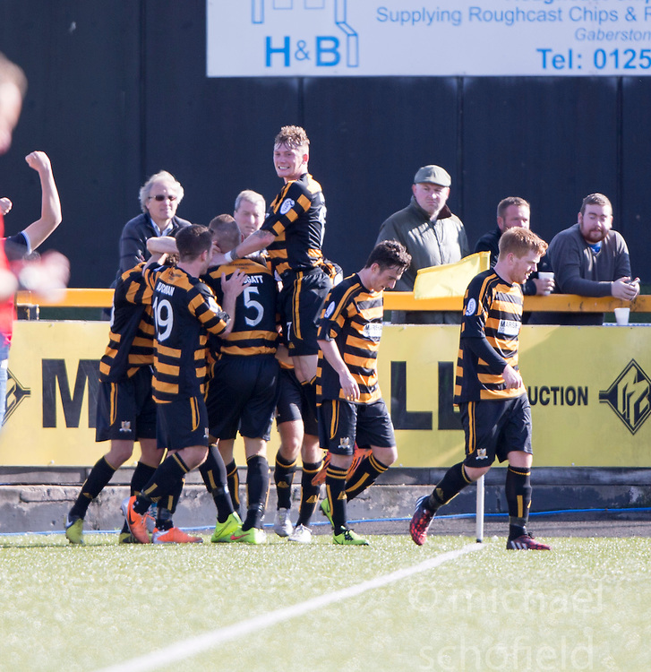Alloa Athletic's Iain Flannigan cele scoring their second goal.<br /> Alloa Athletic 2 v 1 Hibernian, Scottish Championship game played 30/8/2014 at Alloa Athletic's home ground, Recreation Park, Alloa.