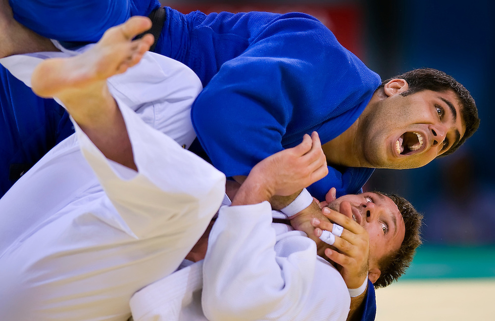 Mohammad Reza Rodaki yelled as his won the match with an ippon on Yury Rybak of Belarus in the men's judo +100 kg class at the UTSB Gymnasium during the 2008 Summer Olympic Games in Beijing, China. (photo by David Eulitt / MCT)