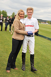 LILA PEARSON and her son GEORGE PEARSON at the St.Regis International Polo Cup between England and South America held at Cowdray Park, West Sussex on 18th May 2013.  South America won by 11 goals to 9 goals.