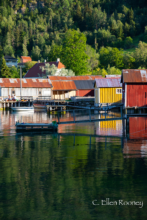 Colourful Solvorn dockhouses reflected in Lustra Fjord, Vestlandet, Norway