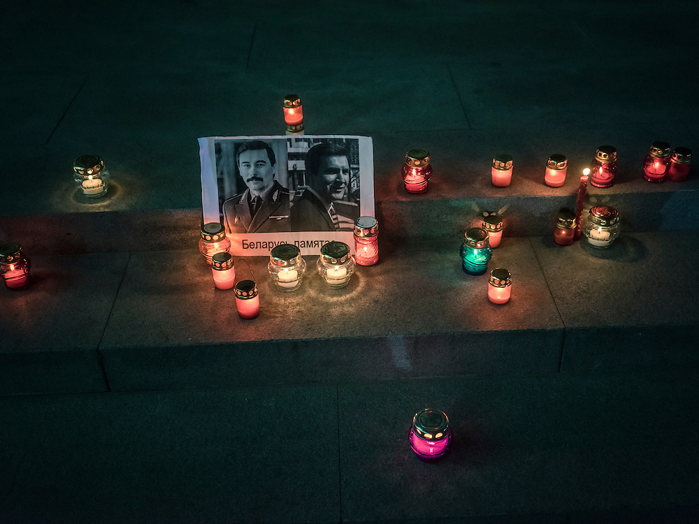 Candles commemorate two men who went missing in 1999 under mysterious circumstances after  a rally organized by Mikalai Statkevich, a former opposition presidential candidate and political dissident, to commemorate the nineteenth anniversary of a referendum which enshrined authoritarian changes in Belarus's constitution on Tuesday, November 24, 2015 in Minsk, Belarus.