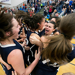 Skyview girls basketball players swarm teammate Hailey Graviet (center, 12, profile) after her three pointer at the buzzer won the game against Rigby High School. Skyview defeated Rigby 36-35 in the 2015 4A girls state basketball game held at Timberline High in Boise, Idaho. Friday February 20, 2015