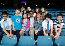 Repro Free: 29/06/2013<br /> Dr Atif Awan, Consultant Nephrologist at Temple Street Children&rsquo;s University Hospital is pictured with just 10 of the 80 children who have received new kidneys at Temple Street since 2003 at a special event in Croke Park to mark 10 years of kidney transplantation at Temple Street. 80 of these children have received a transplant at Temple Street since 2003; 22 from a living donor (a parent or close relative) and 58 from a deceased donor (when the kidney is retrieved from someone who has died but who carried a donor card.) Over the ten years, the youngest recipient of a new kidney was two years of age and the oldest was 17 years. Picture Andres Poveda