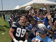 Jul 29, 2018; Costa Mesa, CA, USA; Los Angeles Chargers defensive end Joey Bosa (99) signs autographs during training camp at Jack R. Hammett Sports Complex.