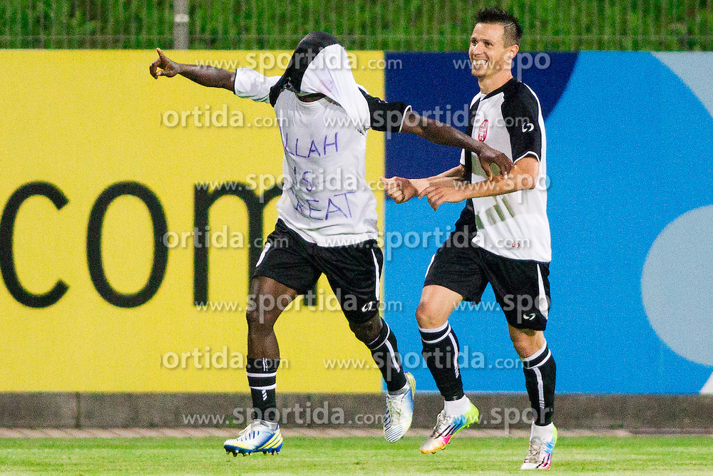"""Adeniyi Segun James of Laci celebrates with underwear sign """"Allah is Great"""" after he scores during football match between NK Rudar Velenje and KF Laci (Albania) in 1st Round of UEFA Europa League Qualifications on July 3, 2014 in Arena Petrol, Celje, Slovenia. Photo By Vid Ponikvar / Sportida"""