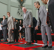 Matt Damon, Brad Pitt, Jerry Weintraub and George Clooney  were immortalized today in front of the Chinese Theatre where they cast their hands, feet, and signatures in cement. The four are involved in the soon to be released film Oceans 13. Photos taken 6-5-2007 in Hollywood, California. photo by John McCoy/LA Daily News